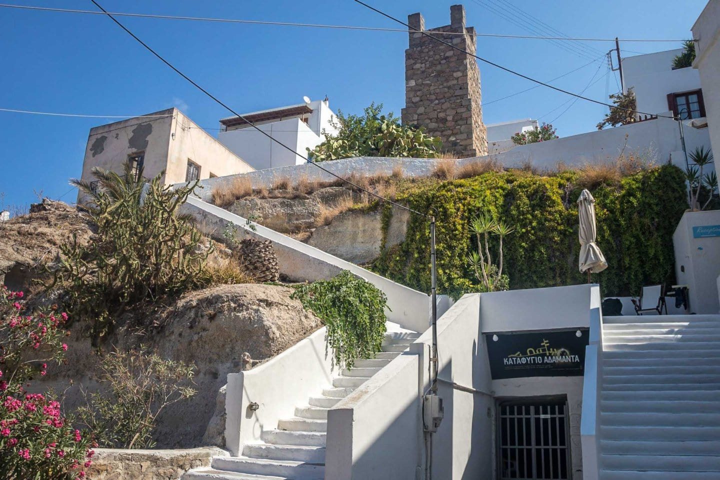 houses built on a hill on top of a world war II bomb shelter in Adamas