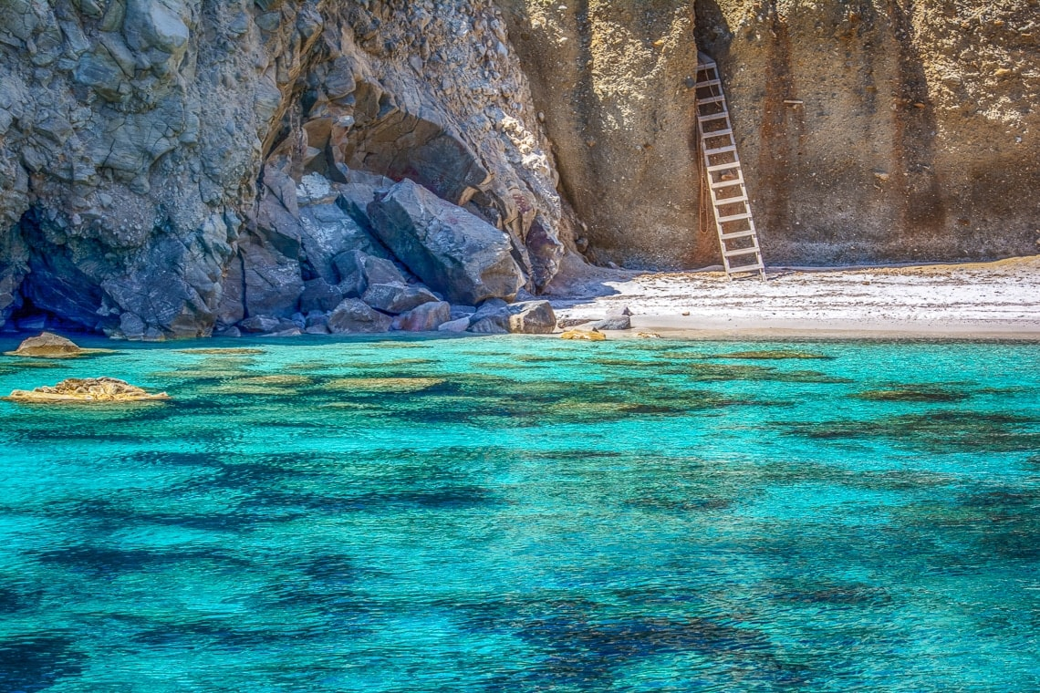 view of a ladder on Tsigrado beach captured from the water